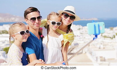Family vacation in Europe. Parents and kids taking selfie...