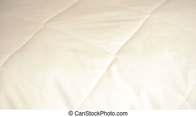 female hand pressing on the pillow. soft pillow - female...