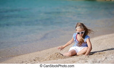Adorable little girl on the beach during greek vacation -...