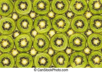 Background from slices of fresh kiwi fruit isolated on white