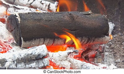 Flames and smoke from burning wood slow motion