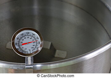 Dial Thermometer in Heating Water - A dial thermometer...