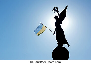 the silhouette in the sunlight of the monument of...