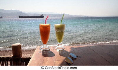 Two cocktails on table fresh cafe on the beach