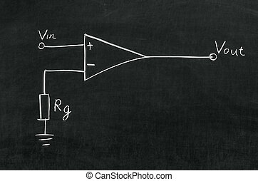 Operational amplifier circuit drawn on the blackboard with...