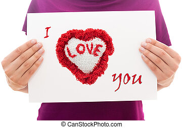 Girl holding white paper sheet with text I love you
