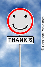 Traffic and street sign with smilie face