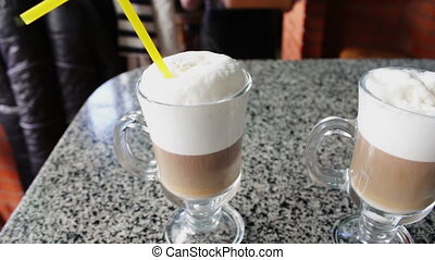 Hot latte with tasty foam - Delicious hot coffee latte with...