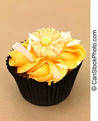 Cup Cake - A freshly baked cup cake with orange frosting