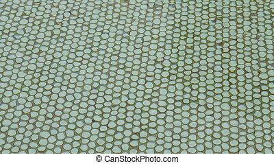 green tiled swimming pool - Rippling water green tiled...