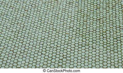 green tiled swimming pool - Rippling water green tiled...