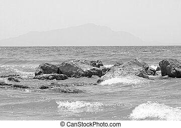 Black and white landscape with mountains and sea