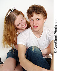 Young girl hugging his boyfriend in a white background.