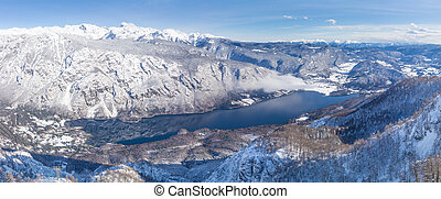 View of the Lake Bohinj and the surrounding mountains in...