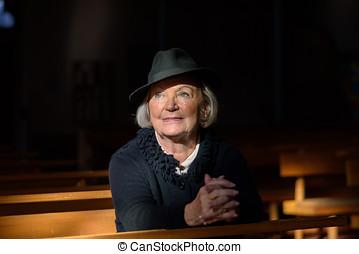 Spiritual image of a senior lady in mourning - Spiritual...