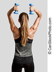 Beautiful fitness woman - Young fitness woman making...
