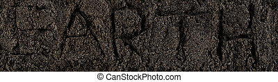 Dark Soil. Pile of Dirt and Stones. Top View of a Heap of Ground. Close Up Macro View with Text earth