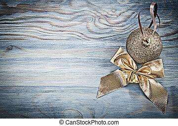 Goldish shiny Christmas bow celebrations concept.