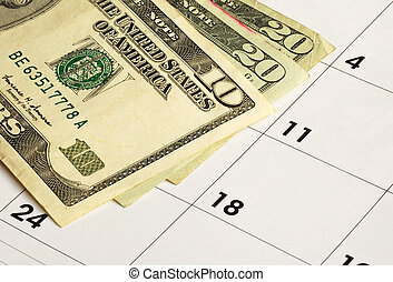 Financial planning - Money on a calendar concepts of...