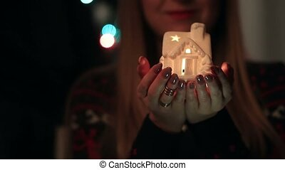 Male and female hands holding luminous house - Close up of...