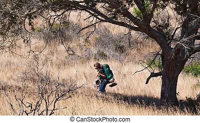 Teen Boy Backpacking - Teen hiking with full backpack...