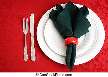 christmas place settings with knife - top view of christmas...