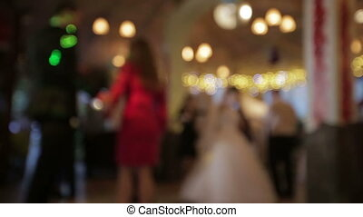 People dancing at a wedding in blur