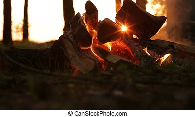 Campfire at sunset closeup - Sunset Campfire. bonfire in the...