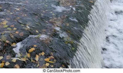Water falls down, close-up 4K