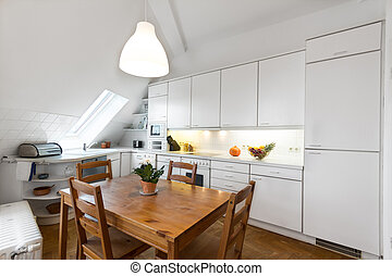 white kitchen with wooden floor in beautiful home - - white...