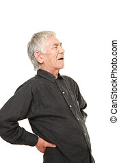 senior Japanese man suffers from lumbago - studio shot of...