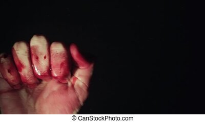 Bloody hand on window glass deep dark background - Bloody...