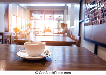 cup of coffee with smoke on table in cafe. - White cup of...