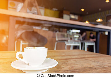 cup of coffee with smoke on wooden table in cafe. - White...