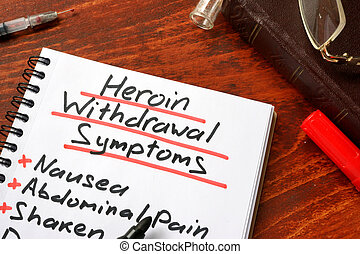 Heroin withdrawal written on a note. Drugs addiction...