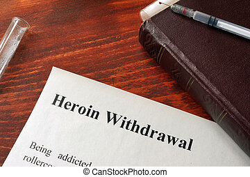 Heroin withdrawal written on a paper. Drug addiction...