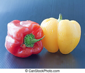 Peppers - Yellow and red peppers on a black background