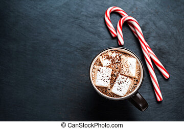 Hot Chocolate with marshmallows and candy stick, traditional...