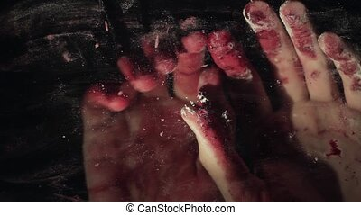 Bloody hand on dirty window glass deep dark background -...