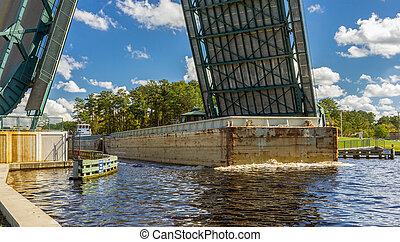 Under the Bridge - A barge tugboat pushing a couple of...