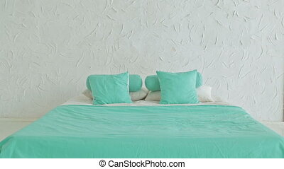 Cheerful woman jumping on bed