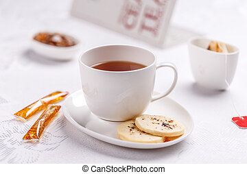 Tea with biscuits - White cup of tea with biscuits