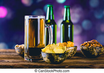 Light beer with snack, party concept