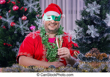 Santa in domino mask toasting - Chubby faced mature smiling...