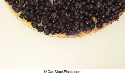 Cheesecake on a plate - Blueberry cheesecake turning around...