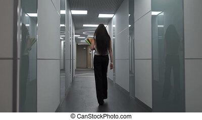 Woman walks down the hall - Business woman walking around...