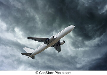 airplane on impressive gray cloud before rain - airplane on...