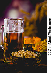 Beer, snack, party concept, wooden table