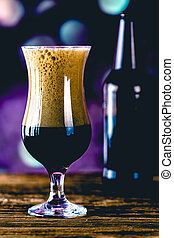 Glass of dark beer, ambient concept