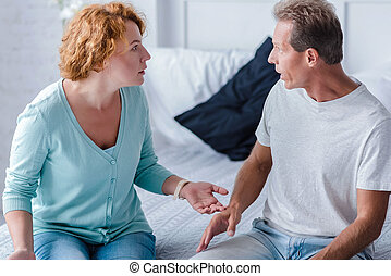 Choleric aged husband and wife quarreling - How can you do...